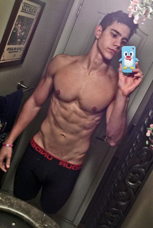 Fit Teen Boy Showing Off His Muscles